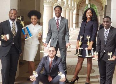 From left are Maliq Wright, Rahmane Dixon, Dimitri Brooks, Emmanuela Wade, Jaylen Bolden, and Louis Mendez, kneeling.